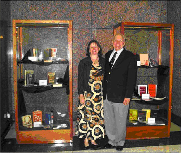 picture of DR. AND MRS. ROBERT D. KING WITH SELECTED VOLUMES OF HIS DONATED COLLECTION TO THE JOHN B. COLEMAN LIBRARY, FEBRUARY 2007
