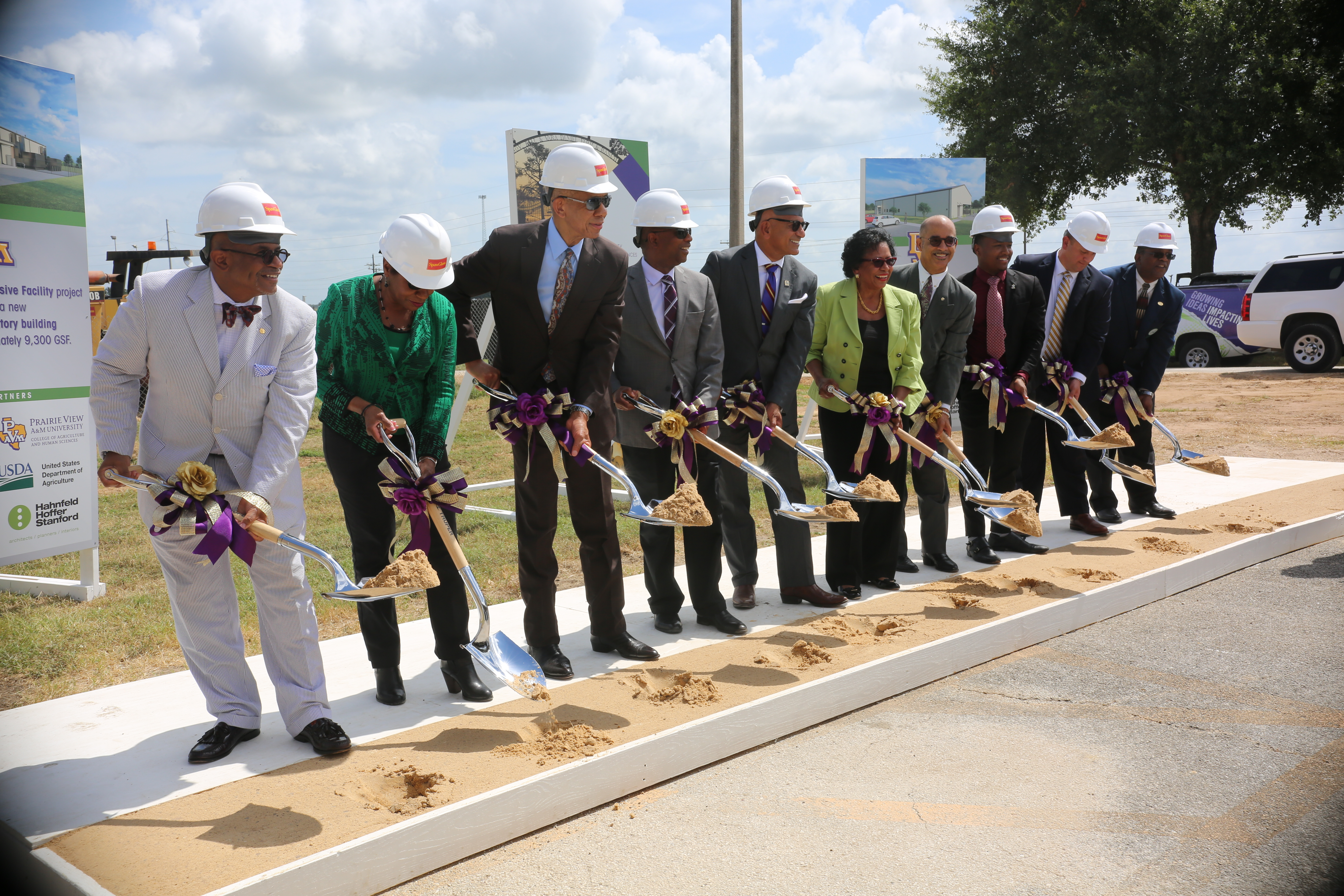 members of the CAHS and University holding shovels of dirt